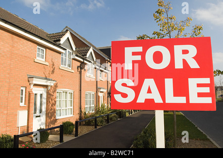 For sale sign and houses - Stock Photo