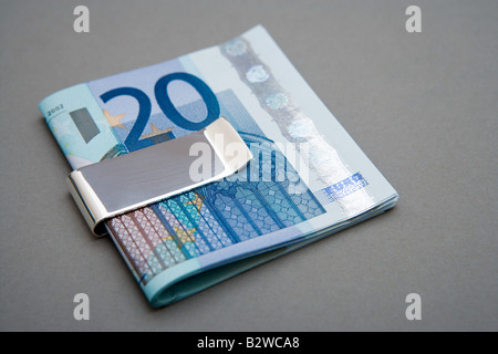 Twenty euro notes in money clip - Stock Photo