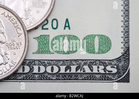 Quarters on one hundred dollar bill - Stock Photo