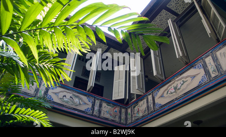 Balcony and shutters The Baba House historic boutique hotel Malacca Malaysia - Stock Photo