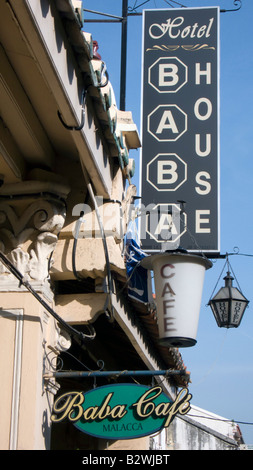 Period signs outside the Baba House historic boutique hotel old town Malacca Malaysia - Stock Photo