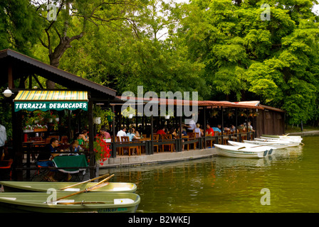 Restaurant patio and rowing boats for hire in Cismigiu Park in Bucharest Romania Europe - Stock Photo