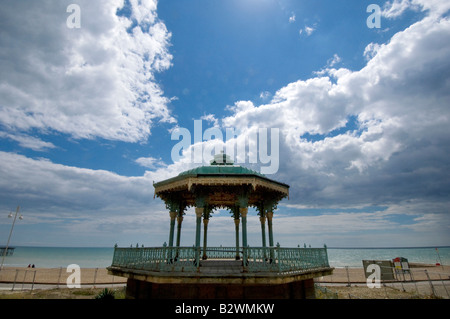 The decaying rusting neglected Victorian bandstand on the promenade of Brighton and Hove - Stock Photo