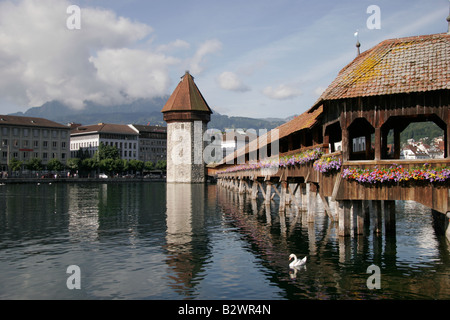 The Chapel Bridge and Water Tower landmarks in Lucerne, Central Switzerland - Stock Photo
