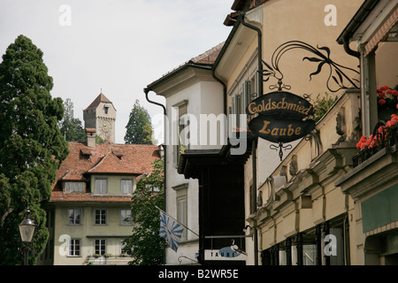 Zyt tower of the Rampart Wall seen on the horizon of a traditional Swiss street in old Lucerne, Central Switzerland - Stock Photo