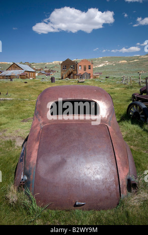 Rusting car in the ghost town Bodie, California - Stock Photo