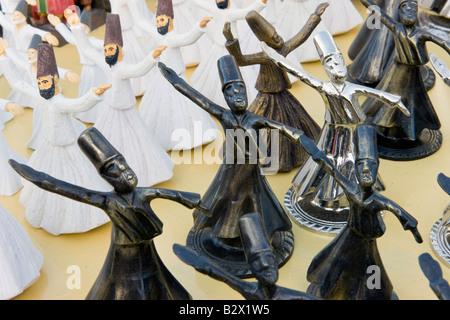Model trinket figures of Whirling Dervishes for sale in Goreme, Cappadocia, Anatolia, Turkey, Asia Minor, Eurasia - Stock Photo