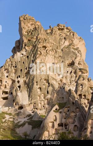 Old troglodytic cave dwellings and the rock Castle of Uchisar, Cappadocia, Anatolia, Turkey, Asia Minor, Eurasia - Stock Photo