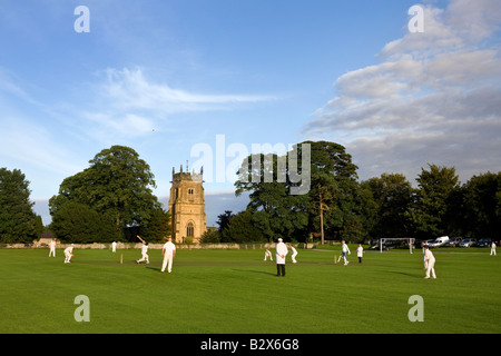 Early evening sunlight on a cricket match in the village of Slingsby in North Yorkshire in North East England - Stock Photo