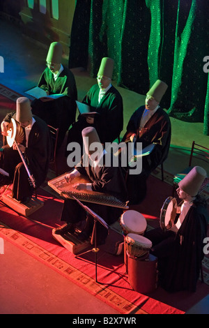 Musicians playing Sufi music during the Sema ceremony by the Mevlevi know as Whirling Dervishes Istanbul Turkey - Stock Photo