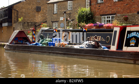 Historic traditional working boat Jubilee with cargo of coal at Stoke Bruerne on the Grand Union Canal Doug Blane - Stock Photo