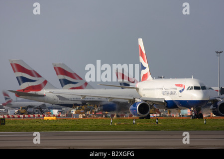British Airways fleet at London Heathrow Airport - Stock Photo