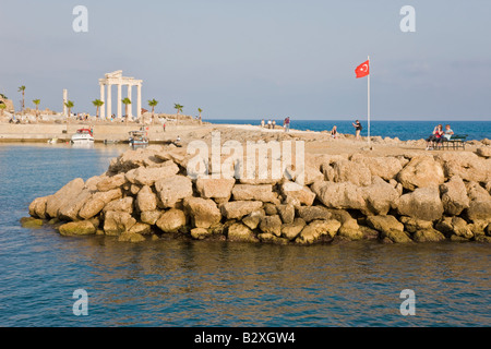 Harbour and marina with reconstructed Roman Temple of Athena / Apollo in the background, Side, Eastern Mediterranean, - Stock Photo