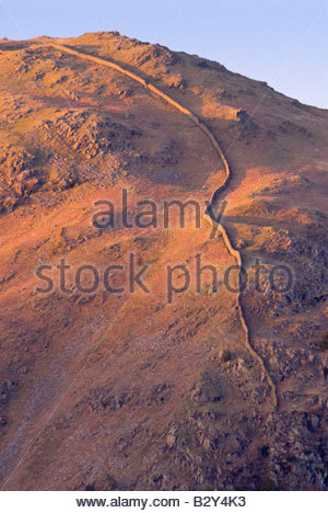 Stone wall on mountainside, Lake District, Cumbria, England. - Stock Photo
