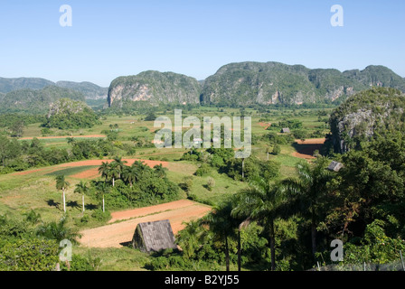 View over Viñales valley towards steep limestone mogotes Cuba - Stock Photo