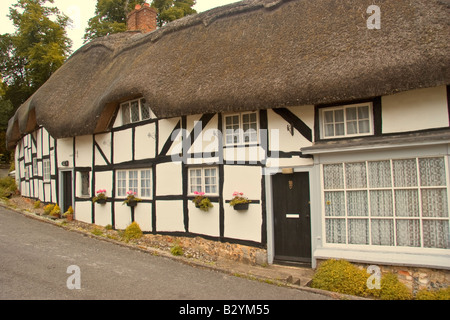Thatched Cottage At Wherwell Hampshire - Stock Photo