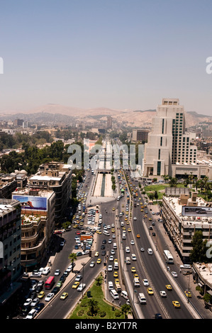 Syria. Morning traffic on wide Beirut Avenue in the modern part of Damascus - Stock Photo