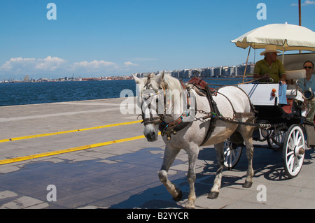 Horse drawn carriage on the waterfront. Thessaloniki, Macedonia, Greece - Stock Photo