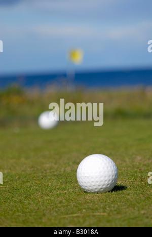 Golf Balls on Green - Stock Photo