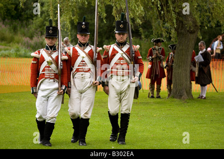 Members of the 68th Durham Light Infantry Display Team wear replica uniforms of the Napoleonic War era. - Stock Photo