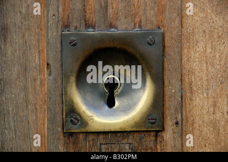 Keyhole in an old door in France - Stock Photo