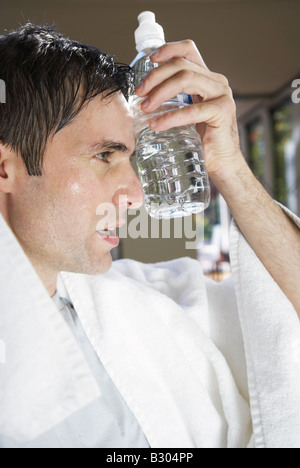 Man with Water Bottle after Exercising - Stock Photo