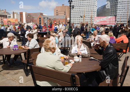 The Pumphouse pub with English people sitting drinking at outdoor tables on a sunny day in summer. Liverpool Merseyside - Stock Photo