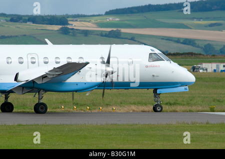 Saab SF 340B Turbo Prop Passenger Aircraft owned by Flybe operated by Loganair at Inverness Airport - Stock Photo