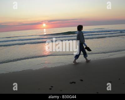 Person walking along beach El Palmar Andalucia Spain - Stock Photo