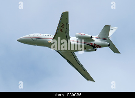 Dassault Falcon 900EX owned by the Danish Lego company leaving Inverness Airfield - Stock Photo