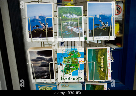Tourist postcards on sale outside a gift shop in Galway city, Ireland - Stock Photo