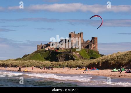 Bamburgh Castle and beach - Stock Photo
