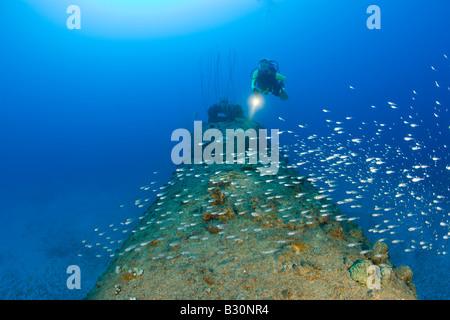 Diver over Stern of USS Apogon Submarine Marshall Islands Bikini Atoll Micronesia Pacific Ocean - Stock Photo