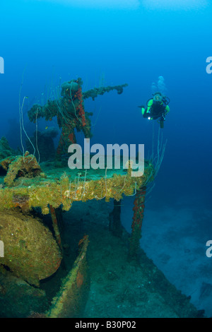Diver and Anti Aircraft Machine Gun at Destroyer USS Lamson Marshall Islands Bikini Atoll Micronesia Pacific Ocean - Stock Photo