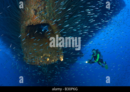 Diver at Anchor Hawse Hole at Bow of USS Saratoga Marshall Islands Bikini Atoll Micronesia Pacific Ocean - Stock Photo