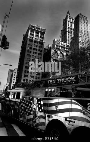 New York fire truck drives through Manhattan street crossing - Stock Photo
