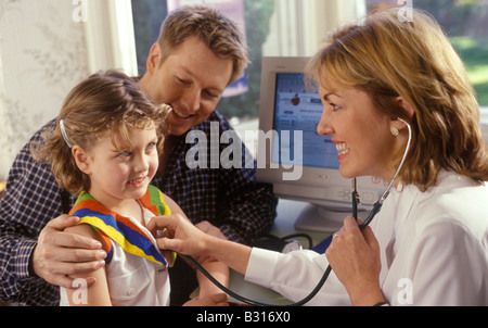 little girl with her father with doctor listening to her chest - Stock Photo