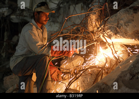 Man Welding Without Any Protective Mask In A Backstreet Of
