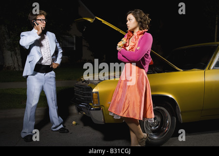 Prom couple with broken down car - Stock Photo