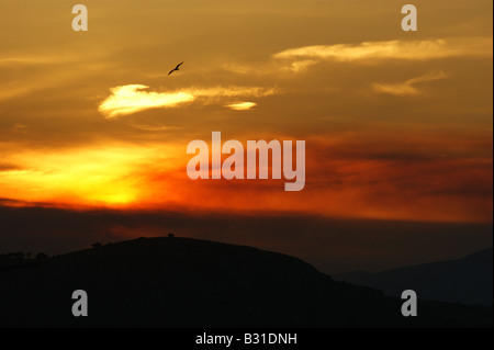 Sunset with smoke from distant forest fire, Elefsina, Greece - Stock Photo