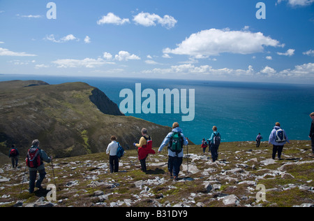 Hikers exploring the Menawn Cliffs, Achill Island, County Mayo, Ireland. - Stock Photo