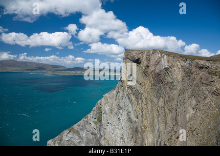 The Menawn Cliffs rising above Keel Bay. Achill Island, County Mayo, Ireland. - Stock Photo