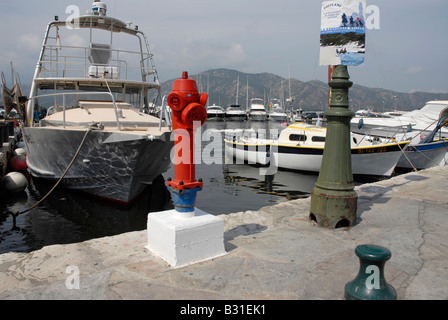 A fire water hydrant on the quay side in Saint Florent harbour on the northern coast of Corsica - Stock Photo
