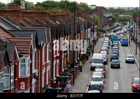 A row of terraced houses in a typical street in the London suburb of Harrow - Stock Photo