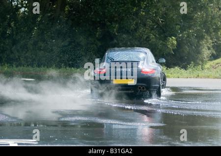 Porsche CARRERA ON SKID PAN - Stock Photo