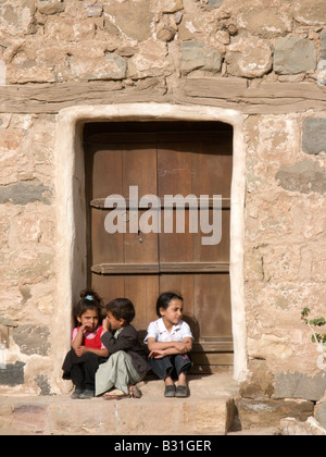 Arab children outside their home near Sanaa, Yemen, Middle East - Stock Photo