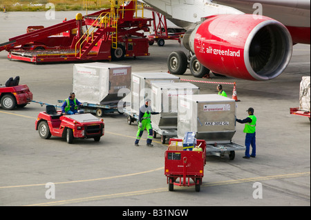 An air Greenland flight at Kangerlussuaq airport bringing freight and tourists to Greenland - Stock Photo