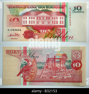 Bank notes from Central Bank Van Suriname - Stock Photo