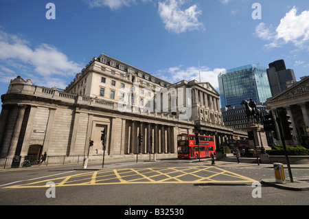 view of Bank of England threadneedle street from the mansion house road junction including box junction london england - Stock Photo
