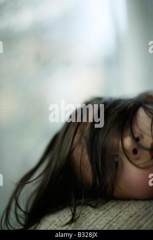 Portrait of five year old girl by window Mixed race Indian ethnic - Stock Photo